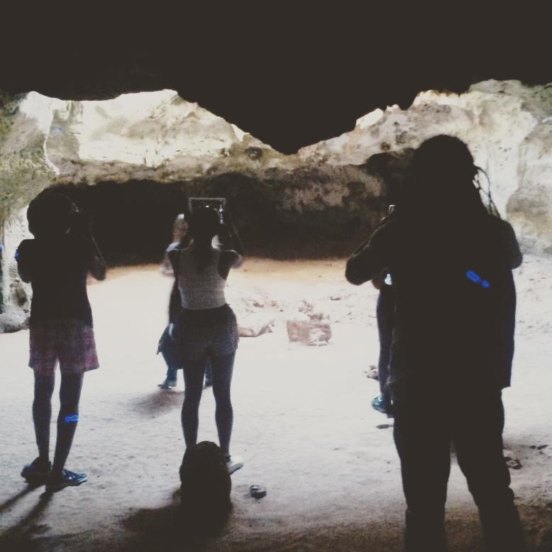 Avantia Damberg, Simone Asia, Ronald Cyrille in Quadirikiri Caves. Photo by Natalie McGuire.