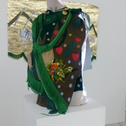 Oneika Russell, Ambassador of The New World, Projected video, found textiles, silicone, treated metal, nylon thread, fabric fringe, enamel, plastic moulded objects, mannequin bust, 2016. Photo courtesy of Katherine Kennedy